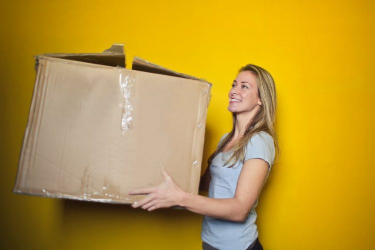 woman holding a big box