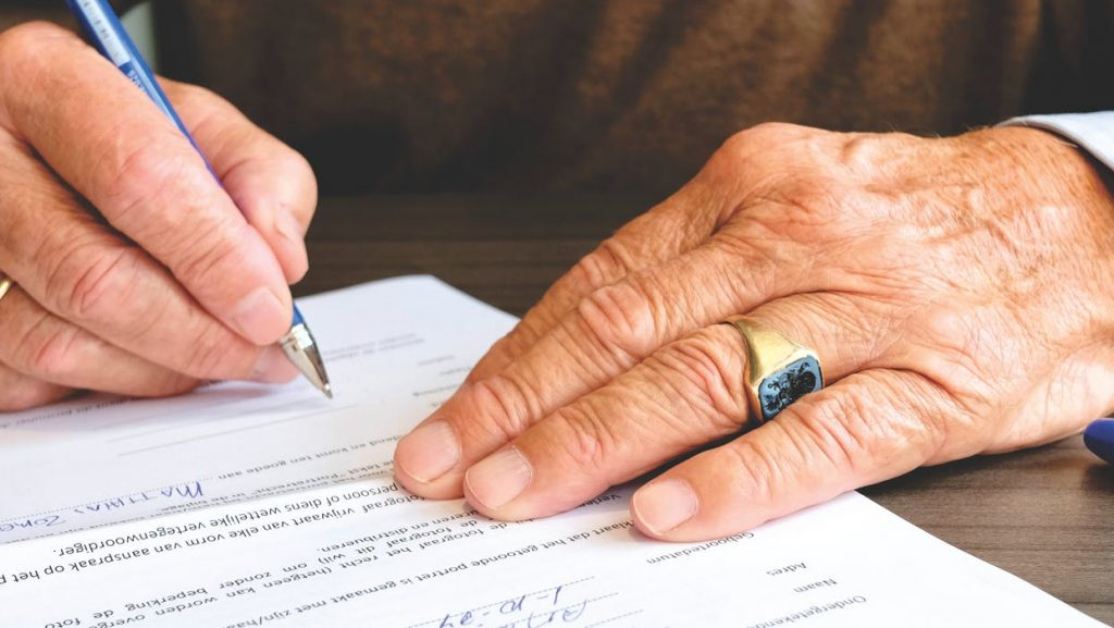 old person signing a will