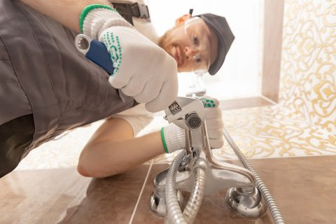 plumber in Wellington while working in the bathroom