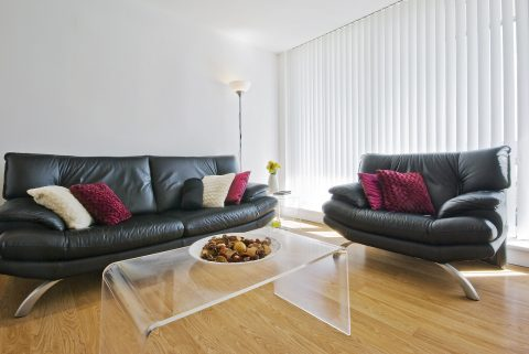 Reception room with hardwood timber floor and sofas