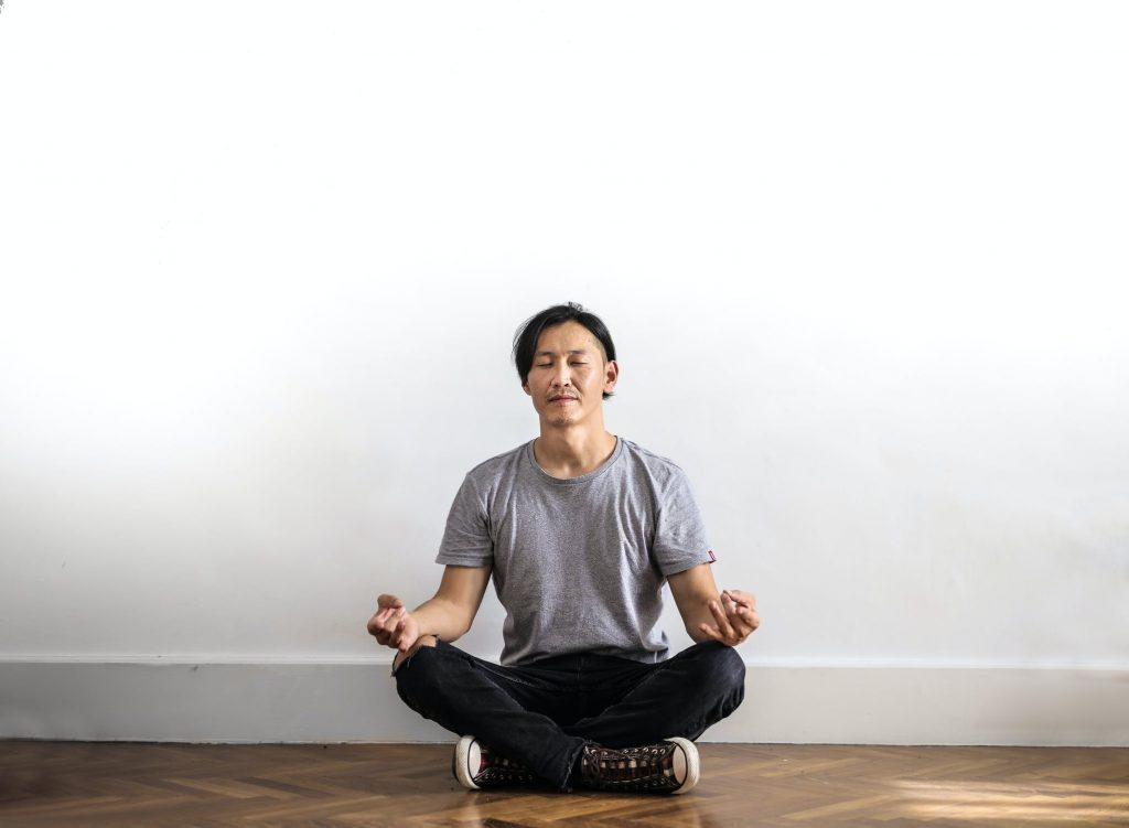 Man practicing meditation