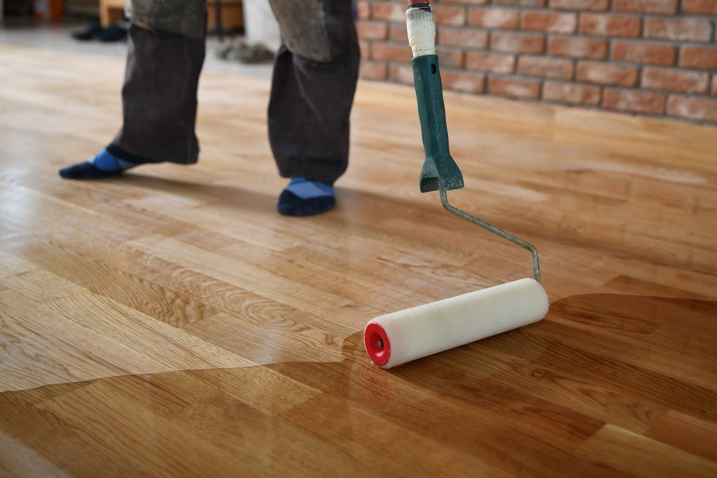 Worker lacquering bamboo flooring in Melbourne