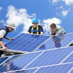 Specialists installing commercial solar units